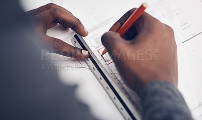 Buy stock photo High angle shot of an unrecognizable male architect making some measurements on his blueprints in a modern office