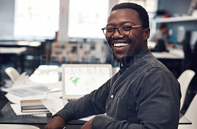 Buy stock photo Cropped portrait of a handsome young male architect smiling while sitting in a modern office