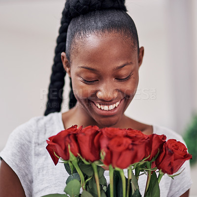 Buy stock photo Cropped shot of a beautiful young woman holding a bunch or roses