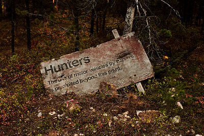 Buy stock photo Shot of a hunting sign and notice in a forest outdoors in nature