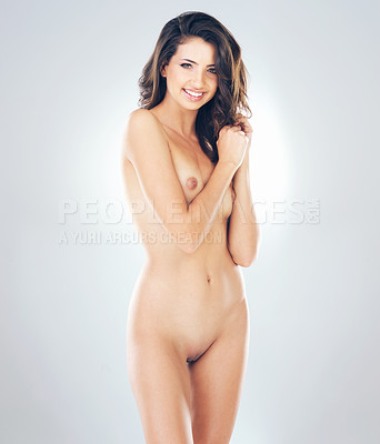 Buy stock photo Studio portrait of a sexy young woman posing nude against a grey background