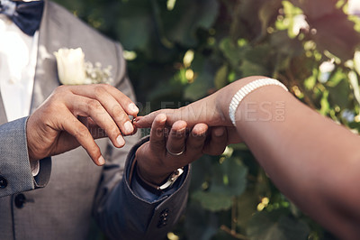 Buy stock photo Cropped shot of an unrecognizable couple exchanging rings during their wedding ceremony