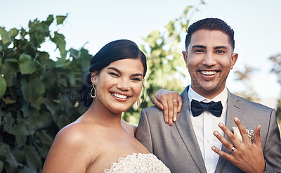 Buy stock photo Cropped shot of a young couple posing outside on their wedding day