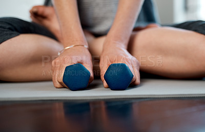 Buy stock photo Low angle shot of an unrecognizable woman practicing yoga while making use of weights inside of a studio during the day