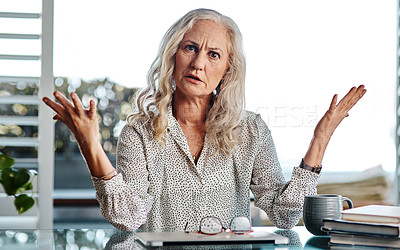Buy stock photo Cropped portrait of an attractive senior businesswoman looking confused while working from home