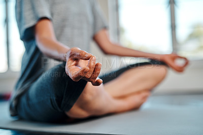 Buy stock photo Shot of an unrecognizable woman practicing yoga while meditating inside of a studio during the day