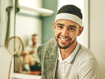 Buy stock photo Shot of a young man taking a break in the locker room after a game of squash
