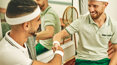 Buy stock photo Shot of two young men shaking hands in the locker room after a game of squash