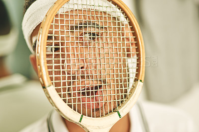 Buy stock photo Shot of a young man pressing his face up against his squash racket