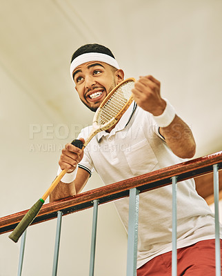 Buy stock photo Shot of a young man watching a game of squash from the viewing gallery