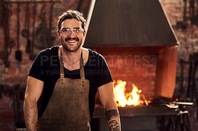 Buy stock photo Portrait of a handsome young metal worker working inside a welding workshop