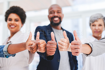 Buy stock photo Shot of a group of businesspeople showing thumbs up in an office