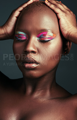 Buy stock photo Cropped shot of a beautiful woman wearing colorful eyeshadow while posing against a grey background