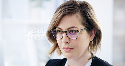 Buy stock photo Shot of a young businesswoman working in an office