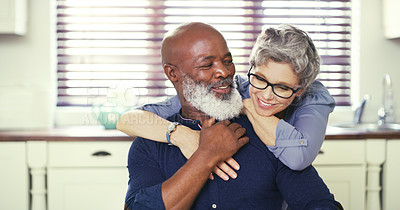 Buy stock photo Shot of an affectionate mature couple at home