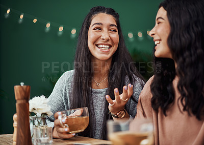 Buy stock photo Shot of young sisters spending quality time at a cafe