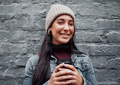 Buy stock photo Cropped portrait of an attractive teenage girl standing against a gray wall in the city and holding a coffee