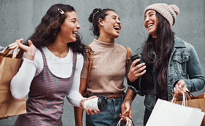 Buy stock photo Cropped shot of an attractive group of sisters bonding together during a shopping spree in the city