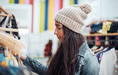 Buy stock photo Cropped shot of an attractive teenage girl standing alone and shopping in the city during the day