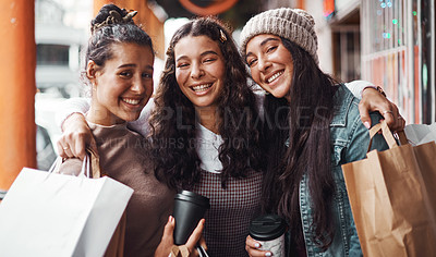 Buy stock photo Cropped portrait of an attractive group of sisters bonding together during a shopping spree in the city