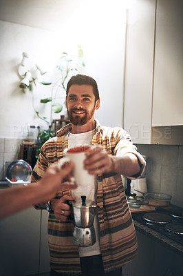 Buy stock photo POV shot of an unrecognizable man receiving a cup of coffee inside of the kitchen during the day