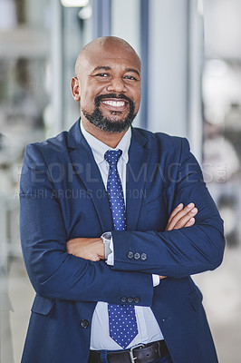 Buy stock photo Portrait of a handsome mature businessman posing inside his office