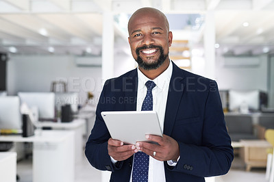 Buy stock photo Portrait of a handsome mature businessman using a digital tablet inside his office