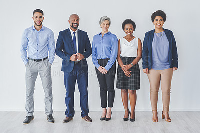 Buy stock photo Full length shot of a group pf businesspeople standing together in line against a white background