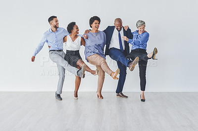 Buy stock photo Full length shot of a group of businesspeople dancing together against a white background