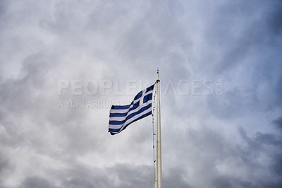 Buy stock photo Cropped shot of the Greek flag underneath an overcast sky during the day in Athens