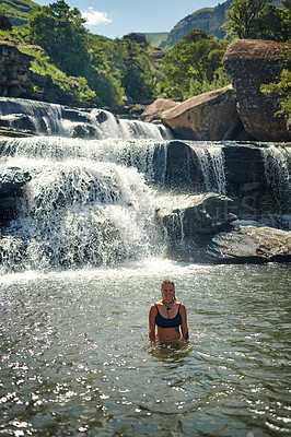 Buy stock photo Cropped portrait of an attractive young woman swimming in a stream alone during a day outdoors