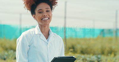 Buy stock photo Cropped portrait of an attractive young female farmer smiling while standing in a crop field
