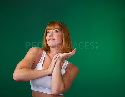 Buy stock photo Cropped shot of an attractive young sportswoman standing alone and posing against a green background in the studio