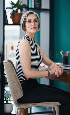 Buy stock photo Cropped shot of a mature businesswoman sitting in a modern office
