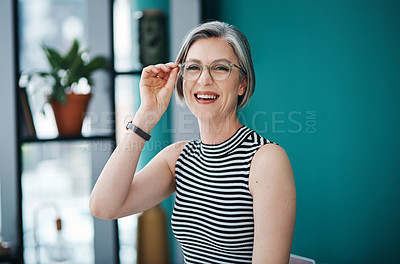 Buy stock photo Cropped shot of a mature businesswoman in her office