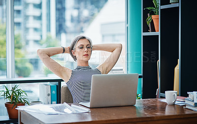 Buy stock photo Shot of a businesswoman looking laid back while sitting at her desk
