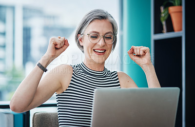 Buy stock photo Shot of a businesswoman looking cheerful while using her laptop