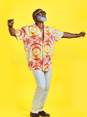 Buy stock photo Full length shot of a funky and stylish senior man dancing in studio against a yellow background