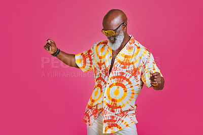 Buy stock photo Cropped shot of a funky and stylish senior man dancing in studio against a pink background