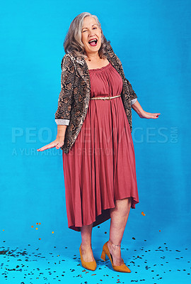 Buy stock photo Full length shot of a funky and stylish senior woman posing in studio against a blue background