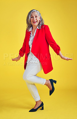 Buy stock photo Full length shot of a funky and stylish senior woman posing in studio against a yellow background