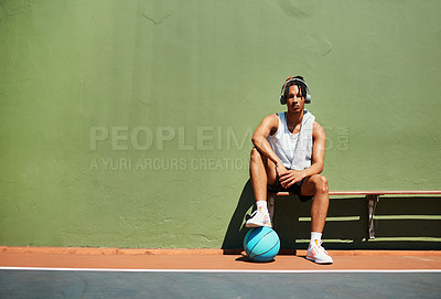 Buy stock photo Portrait of a sporty young man taking a break after a game of basketball