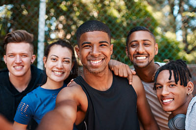 Buy stock photo Portrait of a group of sporty young people taking selfies together outdoors