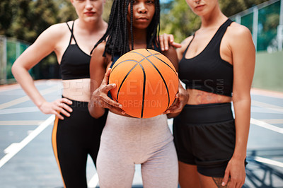 Buy stock photo Closeup shot of a group of sporty women standing together on a basketball court