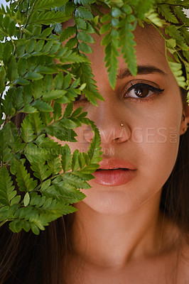 Buy stock photo Portrait of a beautiful young woman with leaves surrounding her face