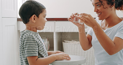 Buy stock photo Cropped shot of an adorable little boy getting ready to paint his mother's nails at home