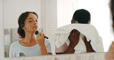 Buy stock photo Cropped shot of a happy young couple getting ready together in the morning inside their bathroom
