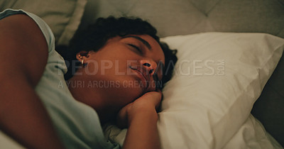 Buy stock photo Cropped shot of an attractive young woman sleeping peacefully in her bed at home
