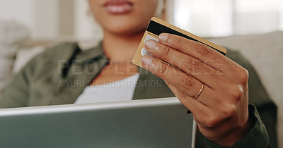 Buy stock photo Cropped shot of an unrecognizable young woman using her credit card and digital tablet at home