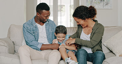 Buy stock photo Cropped shot of a happy young family of three bonding and spending time together at home